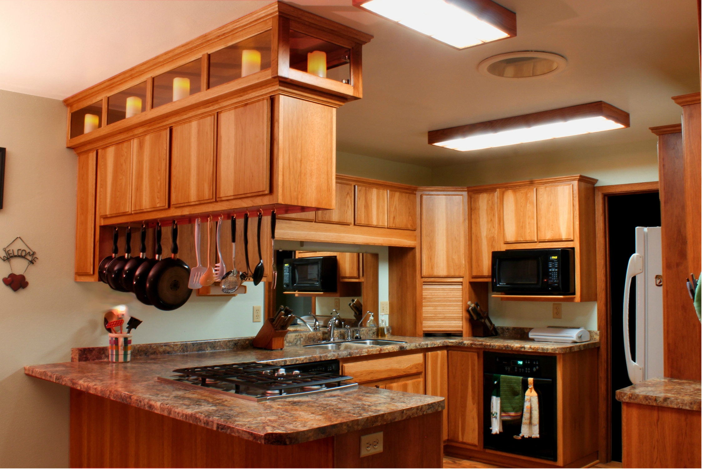 This Kitchen Custom Built In Hickory Features Contemporary Slab Doors